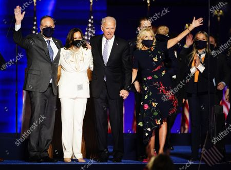 President-elect Joe Biden (2R) and Dr. Jill Biden (R) with Vice President Elect Kamala Harris (2L) and Doug Emhoff (L) are joined by family memebrs wave after Biden delivered his victory address after being declared the winner in the 2020 presidential election in Wilmington, Delaware, USA, 07 November 2020. Biden defeated incumbent US President Donald J. Trump.