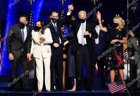 President-elect Joe Biden (2R) and Dr. Jill Biden (R) with Vice President Elect Kamala Harris (2L) and Doug Emhoff (L) are joined by family members after Biden delivered his victory address after being declared the winner in the 2020 presidential election in Wilmington, Delaware, USA, 07 November 2020. Biden defeated incumbent US President Donald J. Trump.