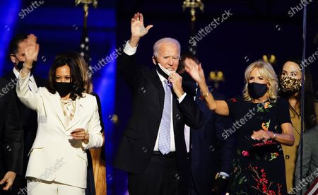President-elect Joe Biden (C) and Dr. Jill Biden (R) with Vice President-elect Kamala Harris (L) are joined by family members after Biden delivered his victory address after being declared the winner in the 2020 presidential election in Wilmington, Delaware, USA, 07 November 2020. Biden defeated incumbent US President Donald J. Trump.