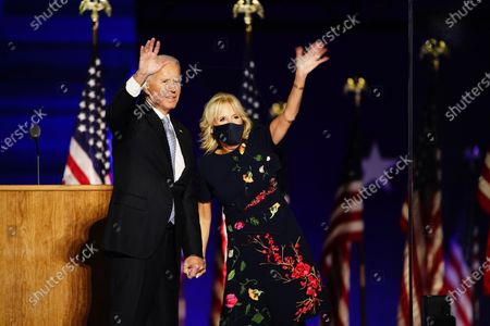 President-elect Joe Biden and Dr. Jill Biden (R) wave after he delivered his victory address after being declared the winner in the 2020 presidential election in Wilmington, Delaware, USA, 07 November 2020. Biden defeated incumbent US President Donald J. Trump.