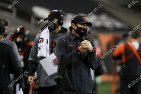Oregon State head coach Jonathan Smith keeps an eye on the field during the second half of an NCAA college football game against Washington State in Corvallis, Ore., . Washington State won 38-28