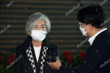 Foreign Minister Kang Kyung-wha (L) responds to a reporter's questions at Incheon International Airport in Icheon, South Korea, 08 November 2020. According to media, Foreign Minister Kang Kyung-wha is on her way to the United States following Joe Biden's presidential election victory.