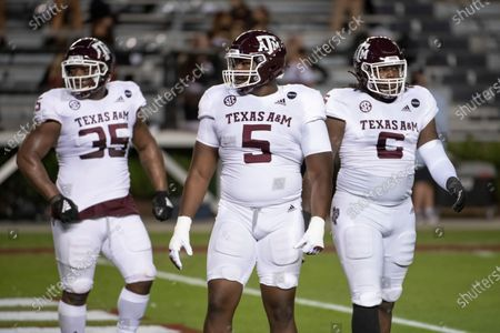 Texas A&M defensive lineman Bobby Brown III (5), McKinnley Jackson (35), and Derick Hunter (6) warm up before an NCAA college football game against South Carolina, in Columbia, S.C. Texas A&M won 48-3