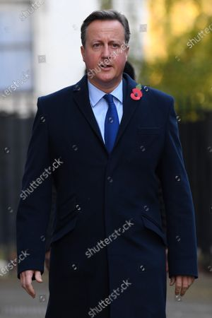 David Cameron, Former Prime Minister of the United Kingdom, in Downing Street on his way to The Cenotaph ahead of Remembrance Sunday Service.