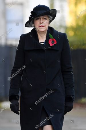 Theresa May, Member of Parliament of the United Kingdom, in Downing Street on her way to The Cenotaph ahead of Remembrance Sunday Service.