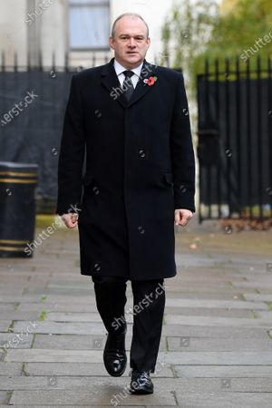 Stock Picture of Ed Davey, Member of Parliament of the United Kingdom, in Downing Street on his way to The Cenotaph ahead of Remembrance Sunday Service.