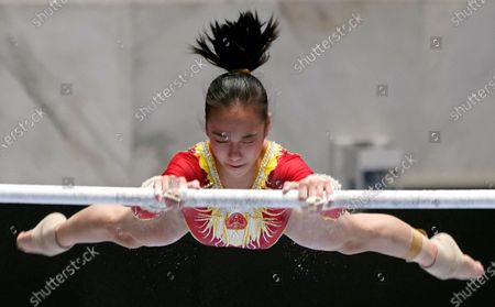 Stock Photo of Zhang Jin of China in action in the women's uneven bars competition during the Gymnastics Friendship and Solidarity Competition in Tokyo, Japan, 08 November 2020. Gymnasts from Japan, China, Russia and the United States participated in an international gymnastics competition with taking measures against COVID-19 coronavirus.