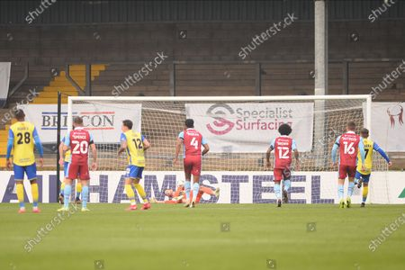 Stock Image of Stephen Gleeson of Solihull Moors scores a penalty 1-0 during the The FA Cup match between Scunthorpe United and Solihull Moors at the Sands Venue Stadium, Scunthorpe