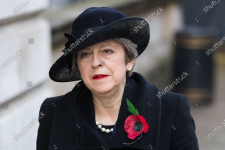 Britain's former Prime Minister Theresa May walks through Downing Street to attend the National Service of Remembrance, on Remembrance Sunday, at The Cenotaph in Westminster, London, Britain, 08 November 2020. Remembrance Sunday events are held across the country as the UK remembers and honours those who have sacrificed themselves in two world wars and other conflicts.