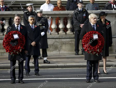 Britain's Mayor of London Sadiq Khan, second left, Labour Party leader Sir Keir Starmer, left, former Prime Minister Theresa May, background right and Prime Minister Boris Johnson stand, during the Remembrance Sunday service at the Cenotaph, in Whitehall, London