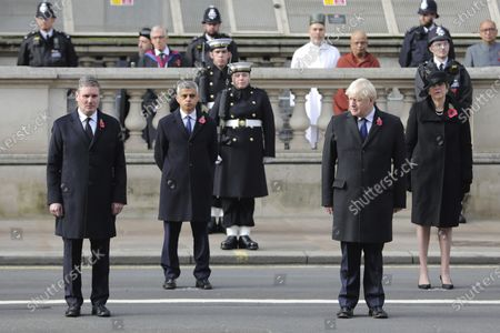 From left, Labour Party leader Sir Keir Starmer, Mayor of London Sadiq Khan, Prime Minister Boris Johnson and former prime minister Theresa May stand, during the Remembrance Sunday service at the Cenotaph, in Whitehall, London