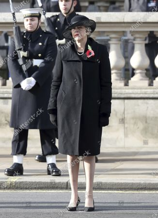 Former British Prime Minister Theresa May stands, during the Remembrance Sunday service at the Cenotaph, in Whitehall, London