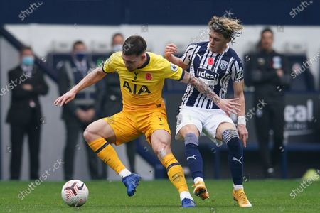 Tottenham's Pierre-Emile Hojbjerg, left, is challenged by West Bromwich Albion's Conor Gallagher during the English Premier League soccer match between West Bromwich Albion and Tottenham Hotspur at the Hawthorns in West Bromwich, England