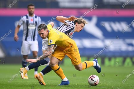 Tottenham's Pierre-Emile Hojbjerg, foreground, fights for the ball with West Bromwich Albion's Conor Gallagher during the English Premier League soccer match between West Bromwich Albion and Tottenham Hotspur at the Hawthorns in West Bromwich, England