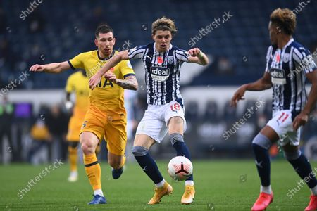 West Bromwich Albion's Conor Gallagher, center, fights for the ball with Tottenham's Pierre-Emile Hojbjerg during the English Premier League soccer match between West Bromwich Albion and Tottenham Hotspur at the Hawthorns in West Bromwich, England