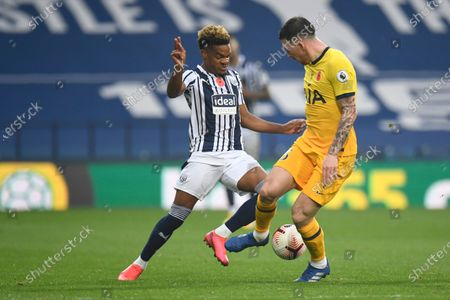 West Bromwich Albion's Conor Gallagher, left, fights for the ball with Tottenham's Pierre-Emile Hojbjerg during the English Premier League soccer match between West Bromwich Albion and Tottenham Hotspur at the Hawthorns in West Bromwich, England