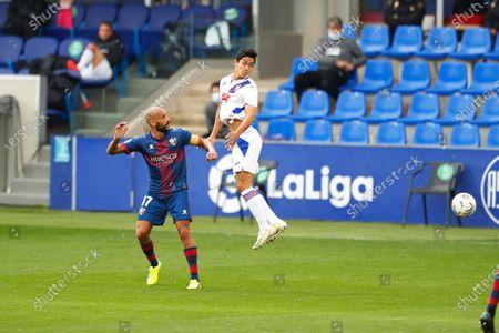 "(L-R) Mikel Rico (Huesca), Yoshinori Muto (Eibar) - Football / Soccer : Spanish ""La Liga Santander"" match between SD Huesca 1-1 SD Eibar at the Estadio El Alcoraz in Huesca, Spain."