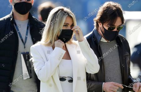 Italian TV journalist Diletta Leotta adjusts her sanitary mask before the Serie A soccer match between Lazio and Juventus at the Rome Olympic stadium