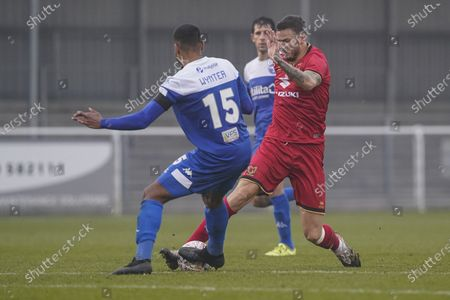 Ben Gladwin of Milton Keynes Dons is tackled by Alex Wynter of Eastleigh during the The FA Cup match between Eastleigh and Milton Keynes Dons at Arena Stadium, Eastleigh