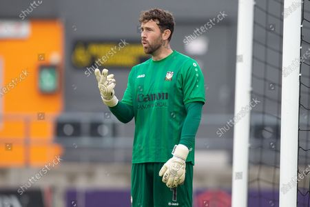 Barnet goalkeeper Scott Loach (1) pointing, signalling, gesturing during the The FA Cup match between Barnet and Burton Albion at The Hive, London