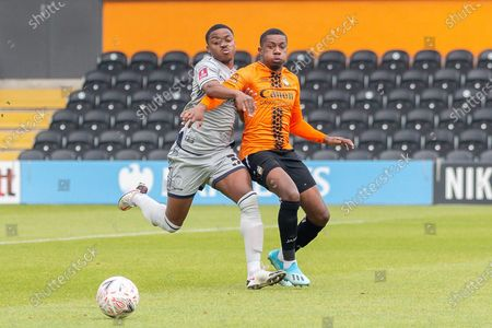 Stock Image of Burton Albion forward Niall Ennis (38) battles for possession with Barnet midfielder Alexander McQueen (7) during the The FA Cup match between Barnet and Burton Albion at The Hive, London