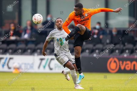 Barnet midfielder Alexander McQueen (7) clears the ball, Burton Albion forward Niall Ennis (38) during the The FA Cup match between Barnet and Burton Albion at The Hive, London