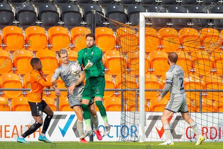 Barnet goalkeeper Scott Loach (1) drops a save, catch, during the The FA Cup match between Barnet and Burton Albion at The Hive, London
