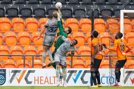 Burton Albion defender Sam Hughes (37) jumps high, Barnet goalkeeper Scott Loach (1) struggles to make a save, during the The FA Cup match between Barnet and Burton Albion at The Hive, London