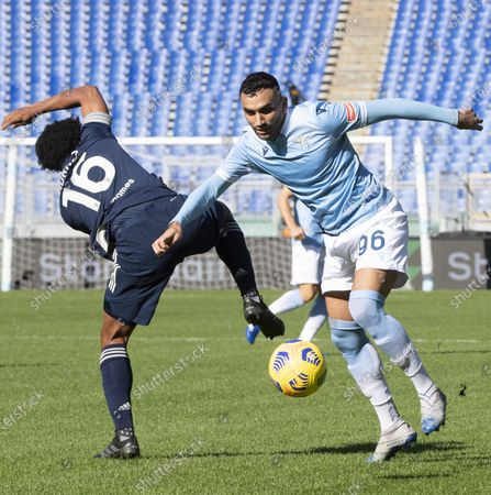 Juventus' Juan Cuadrado (L) and Lazio's Mohamed Fares in action during  the Italian Serie A soccer match SS Lazio against FC Juventus at Olimpico Stadium in Rome, Italy, 08 November 2020.
