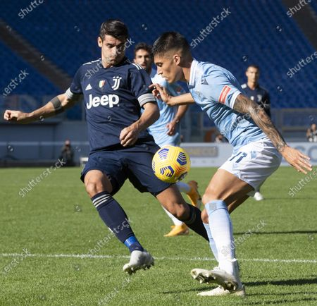 Juventus' Paulo Dybala (L) and Lazio's Joaquin Correa in action during  the Italian Serie A soccer match SS Lazio against FC Juventus at Olimpico Stadium in Rome, Italy, 08 November 2020.