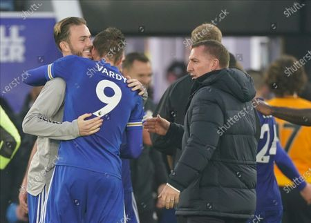 Leicester City manager Brendan Rodgers, right, Leicester City's Jamie Vardy and James Maddison celebrate after the English Premier League soccer match between Leicester City and Wolverhampton Wanderers at King Power Stadium in Leicester, England