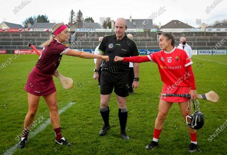 Galway vs Cork. Galway's Sarah Dervan and Amy O'Connor of Cork with Referee John Dermody