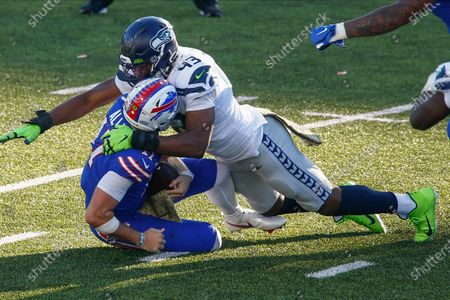Seattle Seahawks Carlos Dunlap, right, sacks Buffalo Bills quarterback Josh Allen during the second half of an NFL football game, in Orchard Park, N.Y