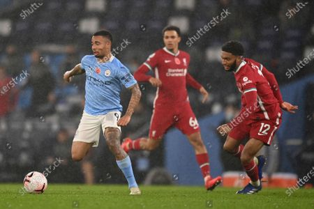 Manchester City's Gabriel Jesus, left, takes on Liverpool's Joe Gomez during the English Premier League soccer match between Manchester City and Liverpool at the Etihad stadium in Manchester, England