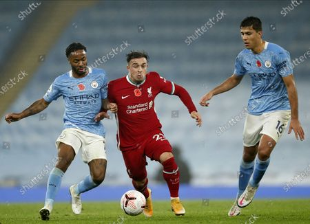 Liverpool's Xherdan Shaqiri (C) in action against Manchester City players Raheem Sterling (L) and Rodrigo (R) during the English Premier League soccer match between Manchester City and Liverpool FC in Manchester, Britain, 08 November 2020.