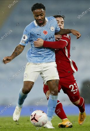 Manchester City's Raheem Sterling (L) in action against Liverpool's Xherdan Shaqiri (R) during the English Premier League soccer match between Manchester City and Liverpool FC in Manchester, Britain, 08 November 2020.