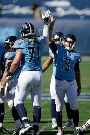 Tennessee Titans kicker Stephen Gostkowski (3) celebrates with offensive tackle Dennis Kelly (71) after Gostkowski kicked a 40-yard touchdown against the Chicago Bears in the first half of an NFL football game, in Nashville, Tenn