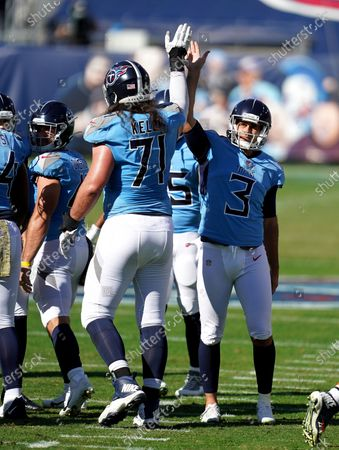 Tennessee Titans kicker Stephen Gostkowski (3) celebrates with offensive tackle Dennis Kelly (71) after scoring a field goal during an NFL football game, in Nashville, Tenn