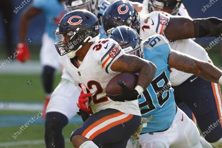 Chicago Bears running back David Montgomery (32) plays against the Tennessee Titans in the second half of an NFL football game, in Nashville, Tenn