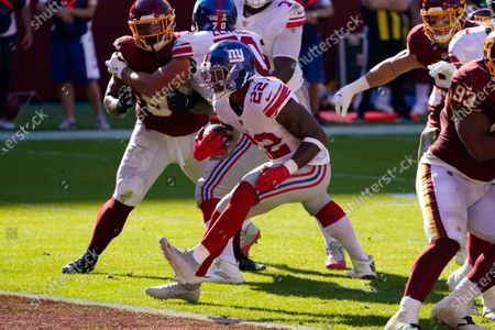 New York Giants running back Wayne Gallman (22) scoring a touchdown against Washington Football Team in the first half of an NFL football game, in Landover, Md