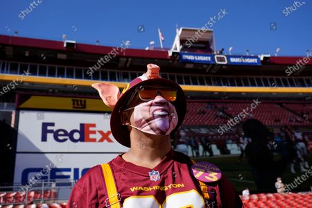 Fan Chris Bryant, from Staunton, Va., in seating area at FedEX Field before the start of an NFL football game between the New York Giants and Washington Football Team, in Landover, Md