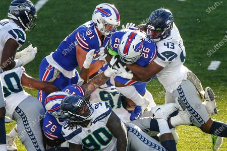 Seattle Seahawks Carlos Dunlap (43) tackles Buffalo Bills' Devin Singletary (26) during the second half of an NFL football game, in Orchard Park, N.Y
