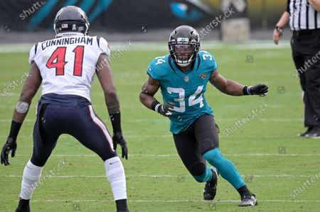 Jacksonville Jaguars running back Chris Thompson (34) goes out for a pass in front of Houston Texans linebacker Zach Cunningham (41) during the second half of an NFL football game, in Jacksonville, Fla
