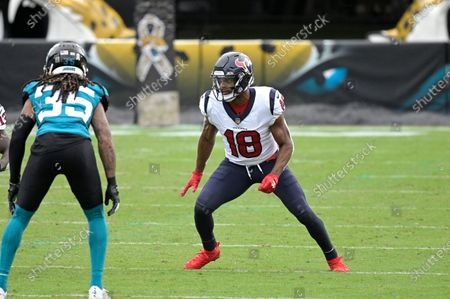 Houston Texans wide receiver Randall Cobb (18) runs a route in front of Jacksonville Jaguars cornerback Sidney Jones (35) during the second half of an NFL football game, in Jacksonville, Fla