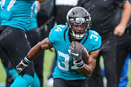 Stock Picture of Jacksonville Jaguars running back Chris Thompson (34) during warm-ups before an NFL football game against the Houston Texans, in Jacksonville, Fla
