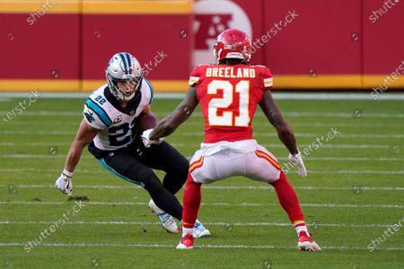 Carolina Panthers running back Christian McCaffrey (22) runs against Kansas City Chiefs cornerback Bashaud Breeland (21) during the second half of an NFL football game in Kansas City, Mo