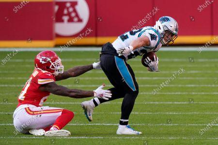 Carolina Panthers running back Christian McCaffrey, right, runs against Kansas City Chiefs cornerback Bashaud Breeland during the second half of an NFL football game in Kansas City, Mo