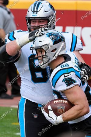 Carolina Panthers running back Christian McCaffrey (22) is congratulated by offensive guard Chris Reed (64) after scoring a touchdown against the Kansas City Chiefs during the first half of an NFL football game, in Kansas City, Mo