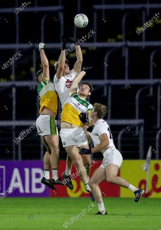 Offaly vs Kildare. Kildare's Kevin Feely wins a high balls against Carl Stewart and Eoin Carroll of Offaly