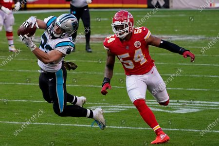 Stock Picture of Carolina Panthers running back Christian McCaffrey, left, catches a pass in front of Kansas City Chiefs outside linebacker Damien Wilson (54) during the second half of an NFL football game in Kansas City, Mo